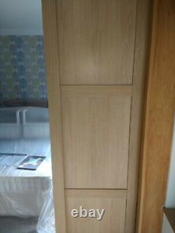 Complete mirror and light oak sliding wardrobe doors used