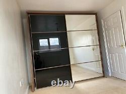 Modern Large Sliding Door double Wardrobe. Mirror/black Buyer to Dismantle