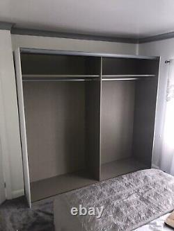 Rauch Sliding Door Wardrobe, Metallic Grey & White German Bedroom Furniture