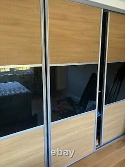 Sliding wardrobe doors with track