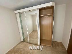 Triple mirror sliding doors wardrobe with built-in spotlights